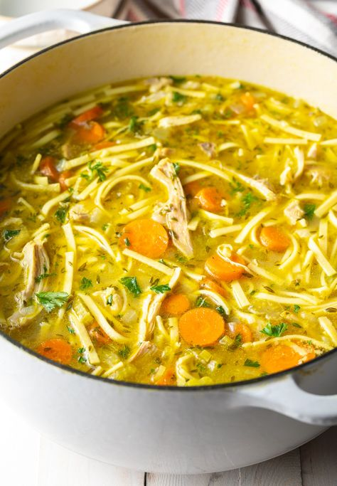 Old-Fashioned Chicken Noodle Soup is the ultimate comfort food. Homemade Old-Fashioned chicken noodle soup with a homemade chicken stock and plump egg noodles, is the ultimate comfort food. Best Chicken Noodle Soup, Chicken Soup Recipes, Seafood Recipes, Recipe Chicken, Homemade Chicken Noodle Soup Recipe, Soups With Chicken Broth, Fideo Soup Recipe, Good Soup Recipes, Chicken Thighs Soup