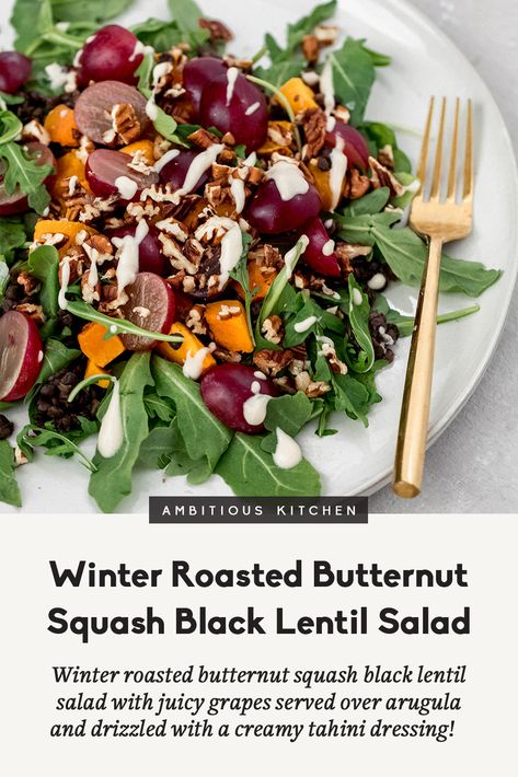 Winter roasted butternut squash black lentil salad with juicy grapes served over a bed of arugula and drizzled with a creamy tahini dressing! Full of texture, comforting and so delicious! #lentils #salad #lunchrecipe #sidedish #thanksgiving #butternutsquash #vegetarianrecipe #veganrecipe #glutenfree