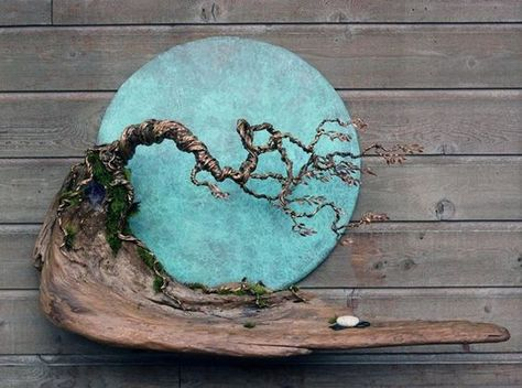 Blue Moon in October Wall Sculpture is designed and hand crafted by artist Marshall Mar of Mars Metal Art.  The Blue Moon in October Wall Sculpture is really unique and special, its balance creates a sense of well being and evokes visions of weathered west coast rainforest trees. The Blue Moon diameter is 27, the full size is 45 x 32-1/2 x 12 wide and is made with 100% recycled materials that include copper, bronze, west coast driftwood, one of a kind beach stones and a very large amethyst c...
