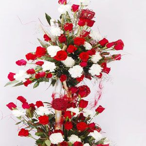 This Extravagant Collection Featuring A 3 To 4 Feet Tall Luxurious Arrangement Of 70 Red Roses And 30 White Carnations With Images Buy Flowers Online Online Flower Delivery