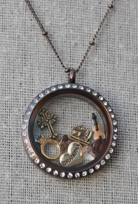 Origami Owl Living Locket...  http://yourcharminglocket.origamiowl.com/ Have further questions, email me at YourCharmingLocket@gmail.com or message me on Facebook https://www.facebook.com/YourCharmingLocket. --- Want more than just one locket, consider joining my team for an extra income.