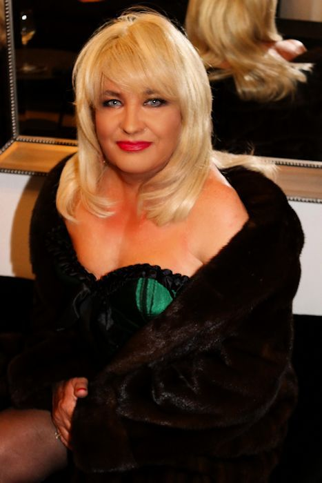 Crossdressing Service Gallery   Crossdressing Service. Suzanne is gorgeous in her satin corset and mink coat.