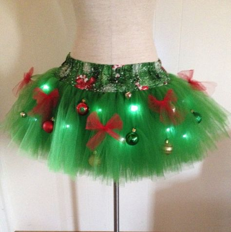 This adult large sized TuTu features green tulle sewn onto a pine tree print fabric waistband. Christmas Tree TuTu is decorated with ornaments,