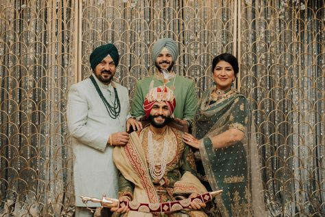 Happy Sikh groom poses with his parents and brother. Photograph by Catch Motion Photography, VA #wedding #familyofthegroom #sikhwedding #indianwedding #photograpy #covidwedding #backyardwedding