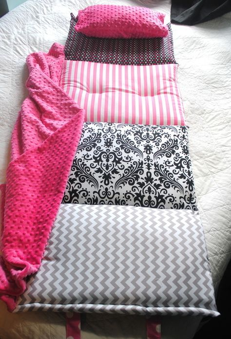 """Janiebee Hollywood Quilted Nap Mat. """"The ultimate in luxury nap mats, Janie Bee's mats are made with luxurious cottons, Minky brand Dimple blankets and TWO inches of thick, soft, quilter's batting. It even includes pillowcase and blanket attached at the side. Use for preschool, sleepovers, or visits to Grandma's! This version is perfect for any girly girl with its trendy pink, white, and black patterns. Also can be personalized."""" -Joanna Dreifus from My Mom Shops"""
