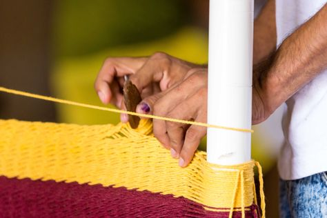 Our skilled workers hand stitching every piece of cotton on our hammock chair.