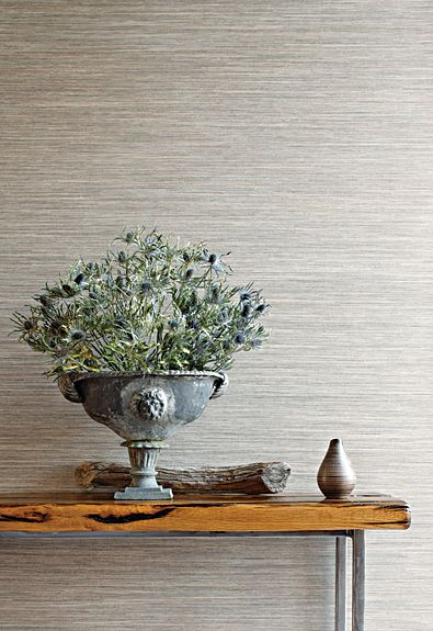 We have a grey grasscloth wallpaper in our home office. It's textured and serene but still adds a level of detail to a room. Love.