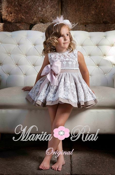 Marina Laencina (this dress is cute for a little girl without the headband, sometimes we use too many accessories on them that instead of look classy and cute they look like a pinata)