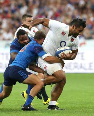 Billy Vunipola gets away from Mathieu Bastareaud and Frederic Michalak during the International match between France and England at Stade de France