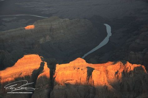 First sun rays of the day illuminating a rock formation while the Colorado river is still sleeping in the shadow. Grand Canyon National Park, AZ, USA #usa #arizona #NationalParks #grandcanyon #tourism #aerialphotography #naturelovers #photographylovers #nofilter #nofilterneeded