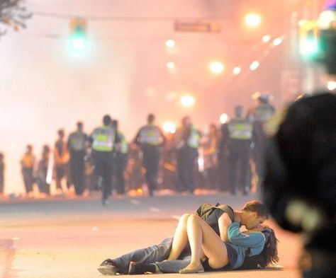 This is the famous photo of a couple kissing in the middle of the Vancouver Stanley Cup riots in 2011. She fell. He helped. They kissed. They're still together! How sweet.