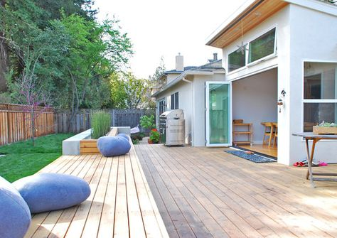Large expansive deck that stretches along the length of the garden