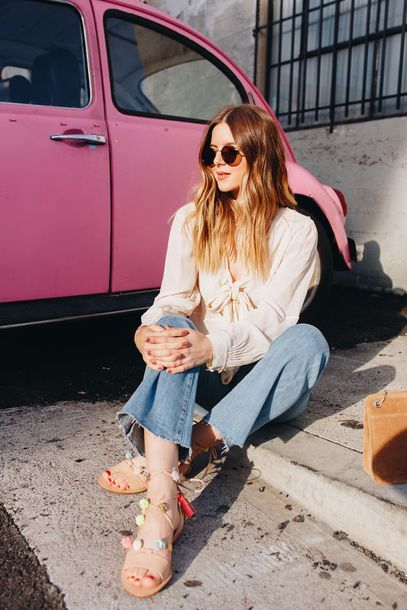 $20 - $100 Cool Casual Blogger Spring Street Style Cut Off Flared Frayed Denim Blue Jeans Pastel Coloured Pom Pom Detail Lace Up Sandals And Retro Round Rayban Sunglasses
