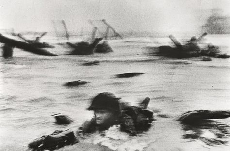 Robert Capa—©International Center of Photography/Magnum Photos  American soldiers landing on Omaha Beach, D-Day, Normandy, France, June 6, 1944    One of the many photos up for auction at the May 15, 2012, Friends of Anton auction.
