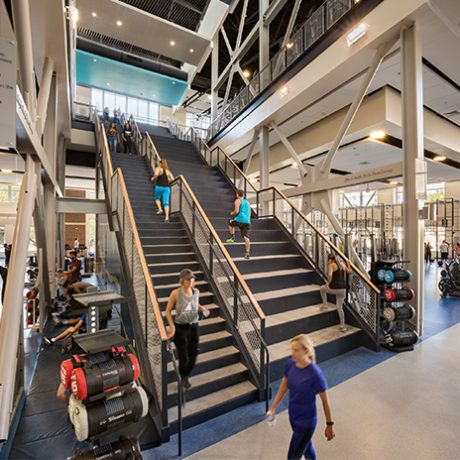 Stadium Stairs Adjacent To Regular Stairs At University Of Nevada Reno S E L Wiegand Fitness Center Design By Hastings Chivetta Gym Design Gym Design