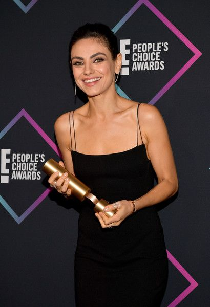 Mila Kunis, Comedy Movie Star of 2018, poses in the press room during the People's Choice Awards 2018.