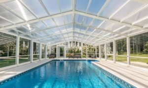 Glass Pool Enclosure Benefits Manufactured By Roll A Cover Swimming Pool Enclosures Indoor Outdoor Pool Pool Enclosures