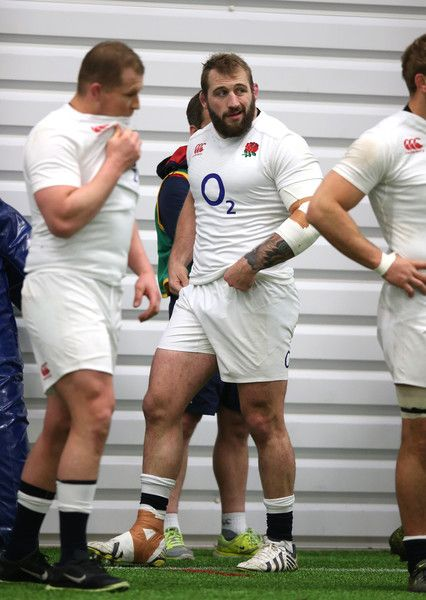 Joe Marler Photos - Joe Marler (C) the England prop, looks on during the England training session held at Pennyhill Park on March 2016 in Bagshot, England.