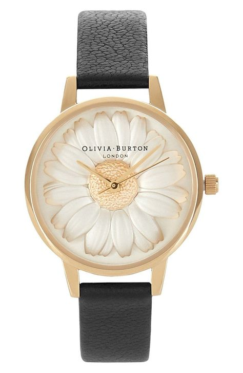Simply adoring the three-dimensional daisy on the dial of this gleaming round watch. A slightly textured leather strap provides a perfect complement to the fanciful design.