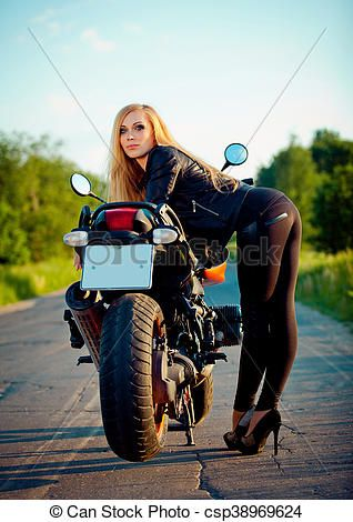 Beautiful Girl standing with a red motorcycle