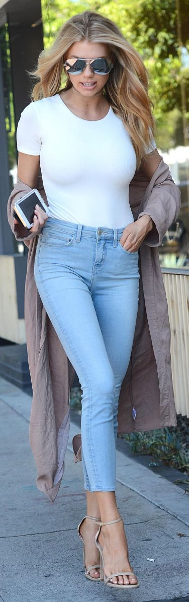 Who made Charlotte McKinney's silver aviator sunglasses, blue skinny jeans, and nude sandals?