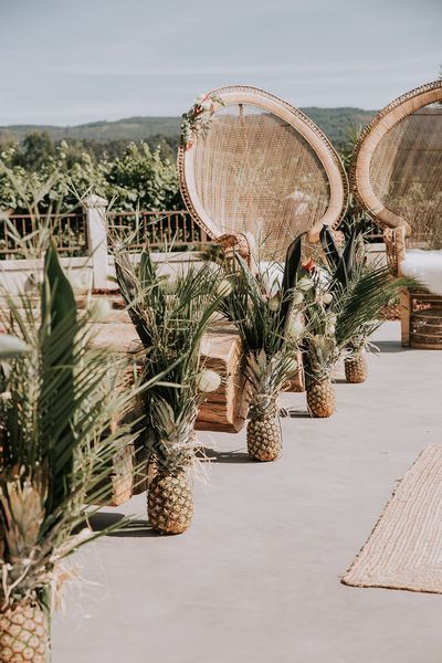 You might want to grab a bottle of wine or a glass of pina colada while looking at Lupe  Alex's tropical vineyard wedding in Rias Baixas Winery -- wooden chairs, pineapples along the aisle, chic wooden favors bouquet with queen proteas and a lot more. Ho