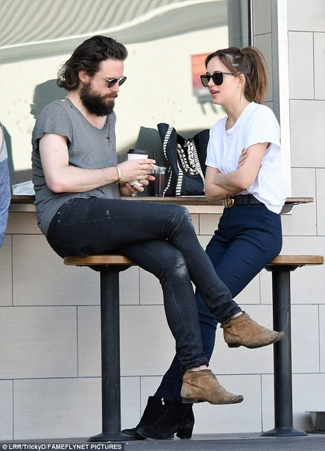 Plenty to talk about: Her male companion appeared to be listening intently to Dakota as she chatted away at an outside seating area at the coffee shop