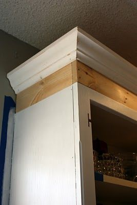 Kitchen cabinet makeover -- height added with board and crown molding -- lick on pix below post for links to further instructions and reveal.  Good DIY instructions