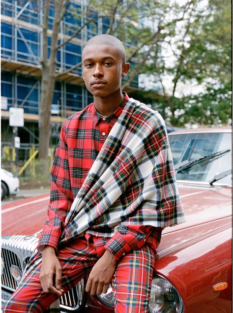 Maximilian in tartan trousers, a check shirt and an oversized scarf. Shot by Ash Kingston for Burberry