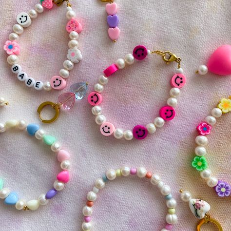 #smallbusiness Colourful pearl jewelry. Handmade jewelry that is made to order. Made with real pearls and colourful beads. It has a very y2k vibe and y2k style. Very aesthetically pleasing. A lot of smiley beads, flower beads and heart beads. Perfect to spice up your outfit. Mostly worn by fashion bloggers. #smallbusinessowner #supportsmallbusiness #handmadejewelry #handmadewithlove #handmadejewellery #jewelry #jewelrydesign #smalljewelrybusiness #smalljewellerybusiness #pearljewelry #pearls #