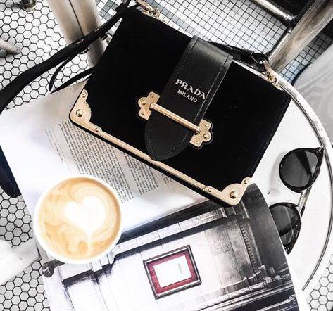 Prada mini velvet bag and a cappuccino on the desk