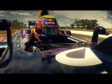 Here S A F1 Car Racing Against A Motorcycle Racing Against A