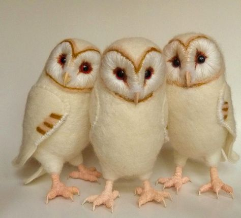 Baby barn owls needle-felted with sheet felt wings and embroidery. Made by fiber artist Helen Priem of