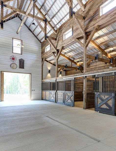 Tour a Stunning Blue Barn in North Carolina STABLE STYLE : Horse barn with open ceiling learn more on Stable Style