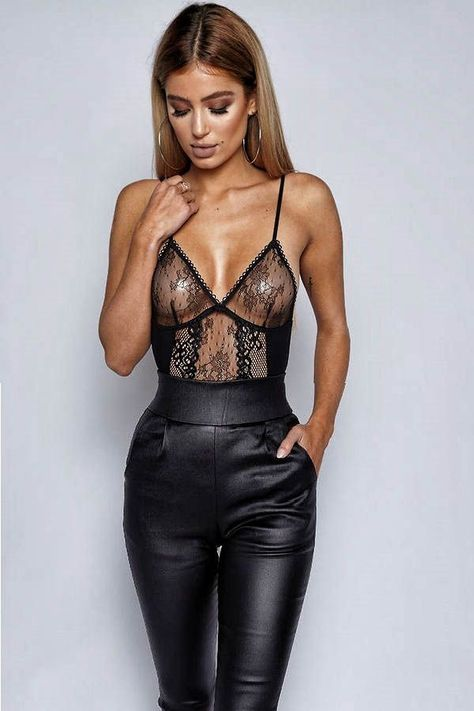 Daring lace top with black, leather like, trousers