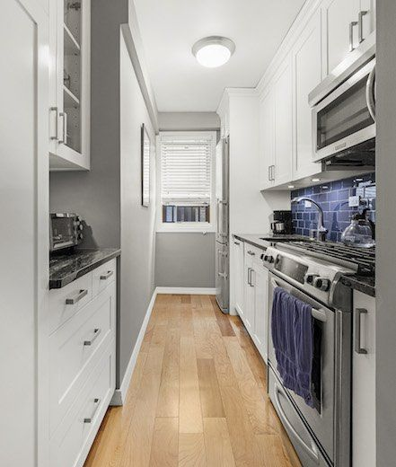 Gray And White Galley Kitchen In New York Small Galley Kitchens