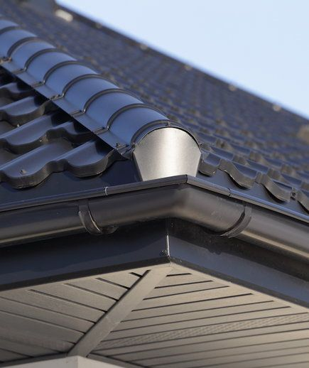 What To Know Before You Hire Someone To Work On Your Gutters Dark Paint Colors Gutters How To Install Gutters