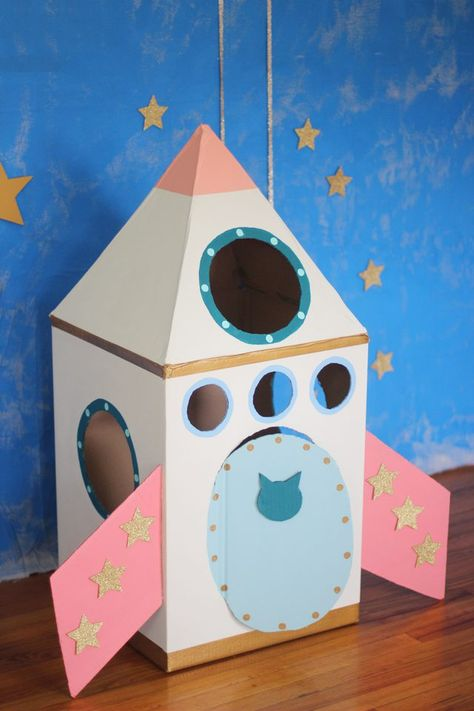 cardboard crafts for cats How To Make A Cardboard Rocket Ship For Your Cat Using Old Boxes Cardboard Crafts Kids, Kids Crafts, Cardboard Rocket, Cardboard Cat House, Cardboard Playhouse, Cardboard Toys, Cat Crafts, Cardboard Spaceship, Cardboard Box Ideas For Kids