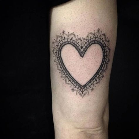 Tricep tattoo of a heart by Ivy Saruzi. Done by Ivy Saruzi