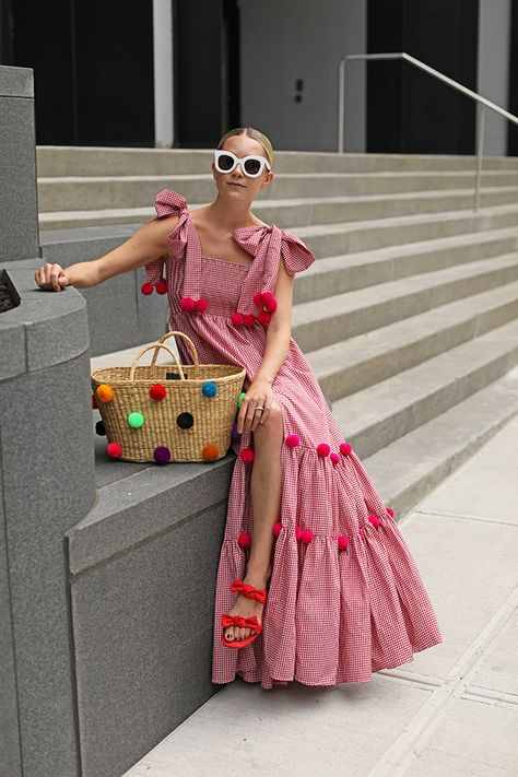POM POM PARTYYYY // Blair Eadie wears a red gingham dress with pom poms by SUNDRESS // Bag by Nannacay // Sunglasses by Celine // Click through for more pom pom outfit picks and summer dress style on Atlantic-Pacific