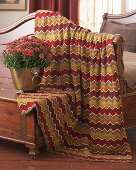 Featuring a gorgeous chevron pattern knit in rich shades of Waverly for Bernat, this blanket is perfect for cuddling up with year-round