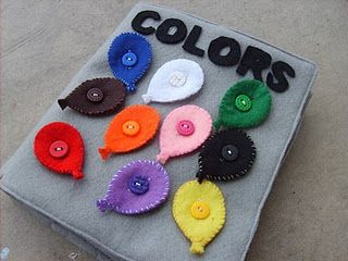 Felt book - colors come unbuttoned, child then picks the correct word by the color of felt and button's it on the page. Fine motor skills