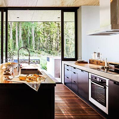 Kitchen walls slide open to the deck