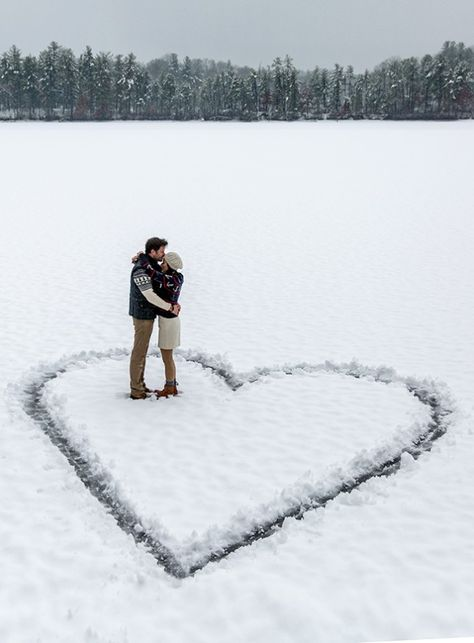 Trace a heart or your initials in the snow for a wintery engagement photo.