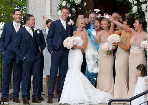 Just really like the shape of her dress and the dark blue suits for the groomsmen- actually love the bridesmaids dresses too (even though they aren't black!!) ;)