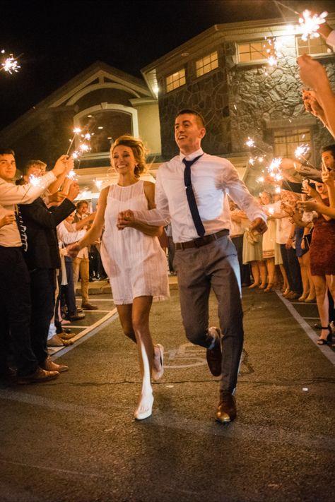 End your wedding night with a spark with the sparkler exit! | Photo: Priscilla de Castro #njweddingvenue #wedding #weddingdress #weddingsparklers #weddingphotoideas #weddingphotos #rockislandlakeclub #brideandgroom