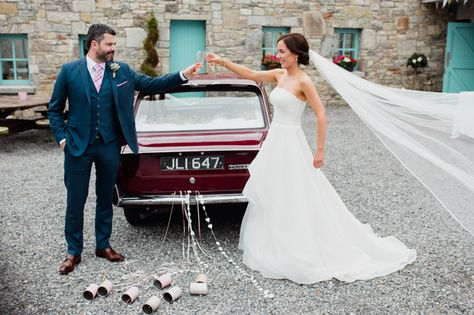 The Bride & Groom with their wedding car.  Groomswear by Louis Copeland & Sons. Photography by: Aidan Beatty Photography