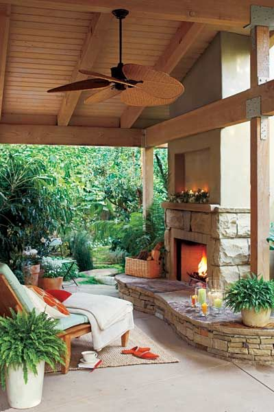 If you've got the space and budget for more than a fire pit, consider putting in a freestanding prefab fireplace and surrounding it with a hearth that doubles as a low sitting wall. | Photo: Thomas J. Story | thisoldhouse.com