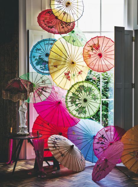 These Oriental parasols make a gorgeous feature in this colourful living room. Image: Livingetc