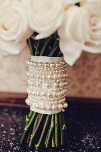 Cream colored rose bouquet with pearl strand wrap